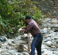 Loading stones from the river bed